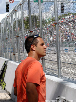 Juan Pablo Montoya watches early race action