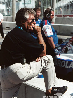 Mario Andretti watches on the wall