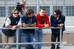 Jimmy Vasser, Oriol Servia, Michel Jourdain and Alex Tagliani take to the pit wall to give their support to Alex Zanardi as he tests a modified Champcar on the Eurospeedway