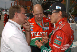 Adrian Fernandez talks with engineers John Dick and Chris Finch