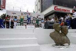 Podium: race winner Paul Tracy with Sébastien Bourdais and Mario Dominguez