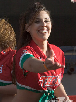Tecate girls toss out some bottle openers to the crowd