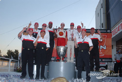 Race winner and 2004 Champ Car World Series champion Sébastien Bourdais celebrates with Carl Haas and Paul Newman