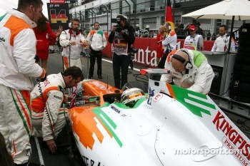Adrian Sutil, here getting ready on the start grid ahead of the race, scored a well-deserved sixth position