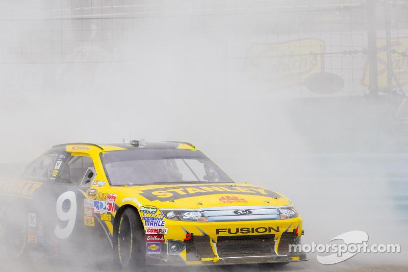 Race winner Marcos Ambrose, Petty Motorsport Ford celebrates
