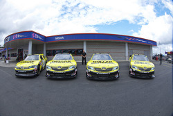 Dollar General unveils 4 cars in front of the media center