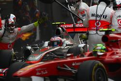 Jenson Button, McLaren Mercedes and Felipe Massa, Scuderia Ferrari  pit stop