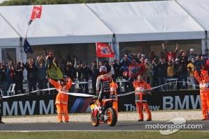 Race winner Casey Stoner celebrates