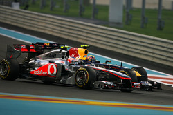 Jenson Button, McLaren Mercedes and Mark Webber, Red Bull Racing