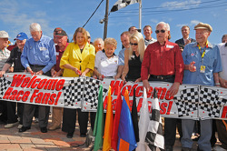Old-timers, including Glen Wood and Vicki Wood assist with ribbon cutting ceremony