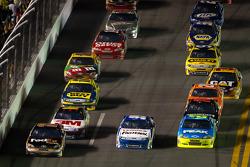 Denny Hamlin, Joe Gibbs Racing Toyota, Carl Edwards, Roush Fenway Racing Ford and Paul Menard, Richard Childress Racing Chevrolet go three-wide
