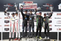 Podium: race winners Ricky Taylor, Jordan Taylor, Wayne Taylor Racing, second place Scott Sharp, Ryan Dalziel, Tequila Patrón ESM, third place Jonathan Bomarito, Tristan Nunez, Mazda Motorsports