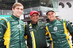 Vitaly Petrov, Caterham with Tony Fernandes, Caterham Team Principal and Heikki Kovalainen, Caterham