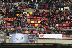 Kimi Raikkonen, Lotus F1 Team fans with banners