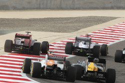 Daniel Ricciardo, Scuderia Toro Rosso and Pastor Maldonado, Williams leads Nico Hulkenberg, Sahara Force India F1 and Vitaly Petrov, Caterham