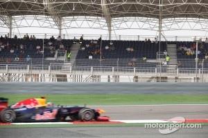 Sebastian Vettel, Red Bull Racing passing an empty grandstand