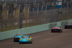 #13 Rum Bum Racing Porsche Carrera: Nick Longhi, Matt Plumb passes #6 Mitchum Motorsports Camaro GS.R: Tim Bell, George Richardson for the lead