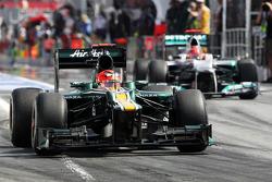 Heikki Kovalainen, Caterham and Michael Schumacher, Mercedes AMG F1 leave the pits