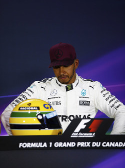 The post-qualifying press conference: Lewis Hamilton, Mercedes AMG F1, shows off his Ayrton Senna helmet, a gift after equalling the Brazilian's pole record