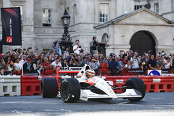 Stoffel Vandoorne, McLaren, demonstrates a 1991 McLaren MP4/6 that was raced by Ayrton Senna