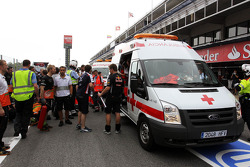 Emergency crews help victims after a fire broke out in the Williams F1 Team pit area