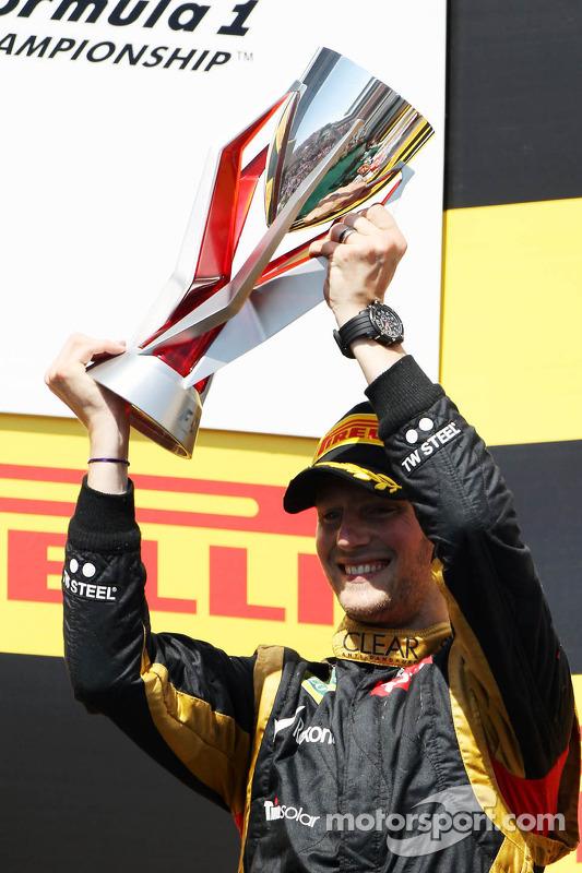 Romain Grosjean, Lotus F1 Team celebrates his second position on the podium
