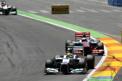 Nico Rosberg, Mercedes AMG F1 leads Jenson Button, McLaren Mercedes
