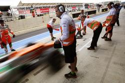Sahara Force India F1 Team mechanics in the pits