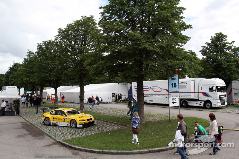 The BMW Motorsport Race Taxi, a BMW M3 GT2 GTE driven by Dirk Adorf, sits in the paddock