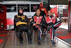 Team Members watch the racing