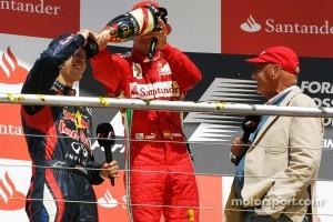 Sebastian Vettel, Fernando Alonso, and Niki Lauda in a 2012 scene on podium.