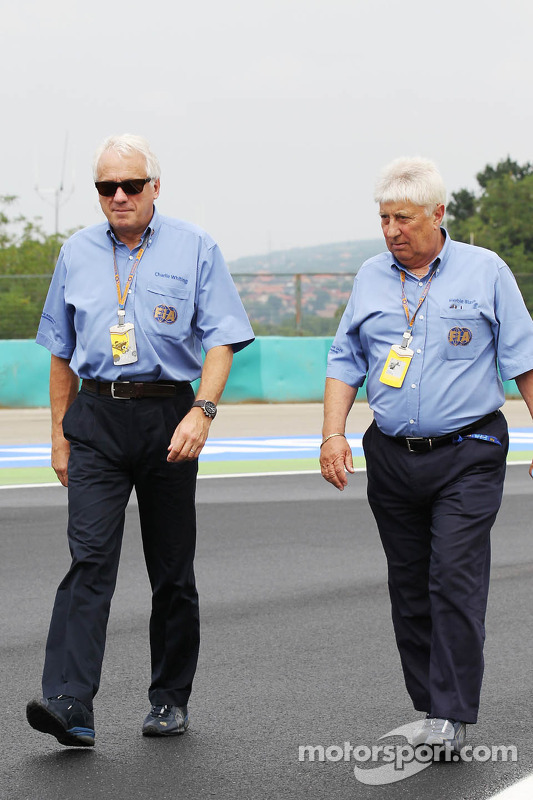 Charlie Whiting, FIA Delegate walk the circuit with Herbie Blash, FIA Delegate