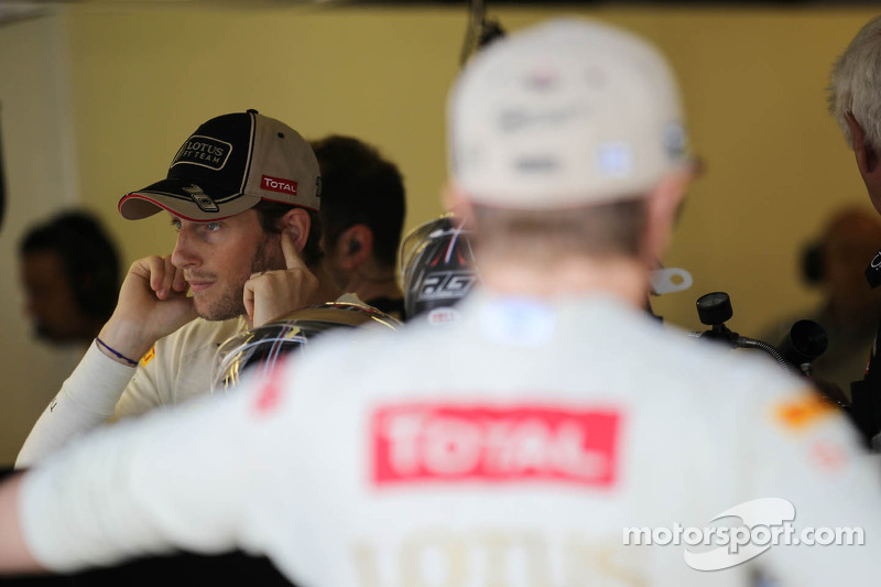 Romain Grosjean, Lotus F1 Team met Kimi Raikkonen, Lotus F1 Team