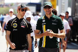 Romain Grosjean, Lotus F1 Team with Vitaly Petrov, Caterham