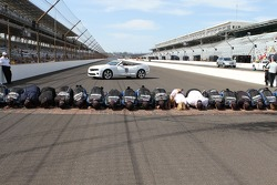 Race winner Jimmie Johnson, Hendrick Motorsports Chevrolet and his team kiss the yard of bricks