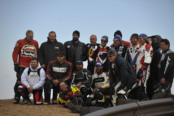 Motorcycle competitors pose for a picture near the summit