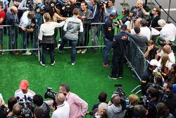 Jenson Button, McLaren; Michael Schumacher, Mercedes AMG F1 and Jean-Eric Vergne, Scuderia Toro Rosso with the media