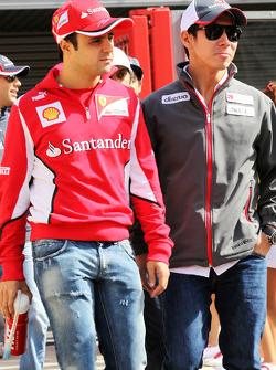 Felipe Massa, Ferrari with Kamui Kobayashi, Sauber on the drivers parade