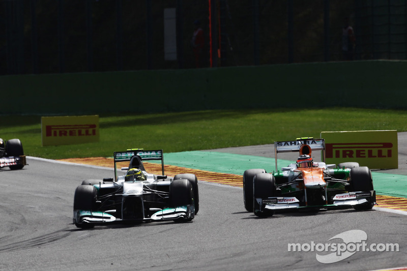 Nico Rosberg, Mercedes AMG F1 and Nico Hulkenberg, Sahara Force India F1 battle for position