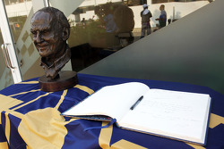 A bronze statue and a book of condolences for the late Sid Watkins, Former FIA Safety Delegate