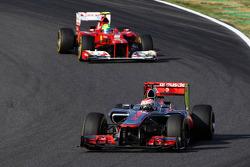 Jenson Button, McLaren leads Felipe Massa, Ferrari