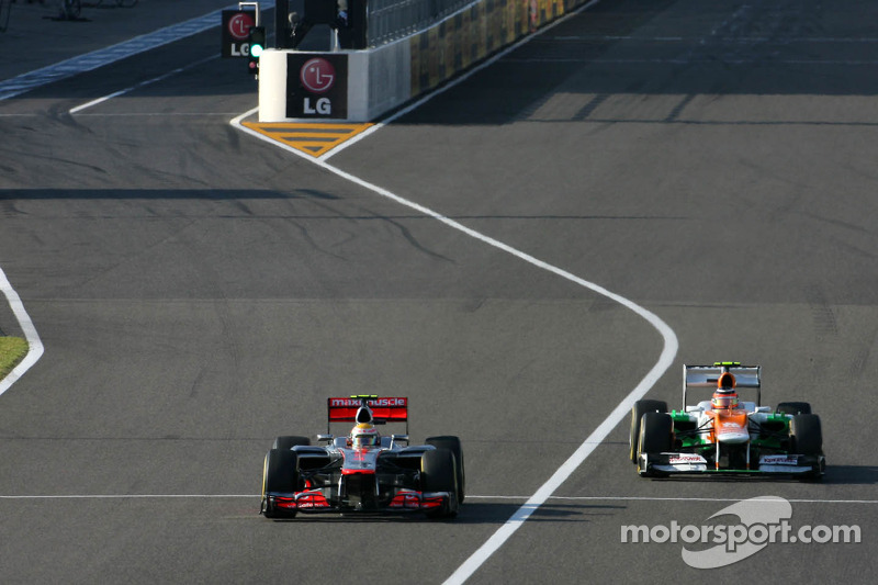 Lewis Hamilton, McLaren Mercedes en Nico Hulkenberg, Sahara Force India Formula One Team
