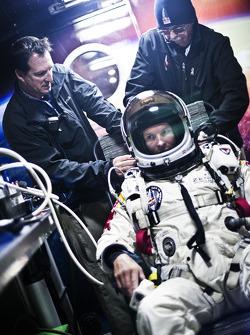 Felix Baumgartner prepares to jump from over 128,000 feet in altitude
