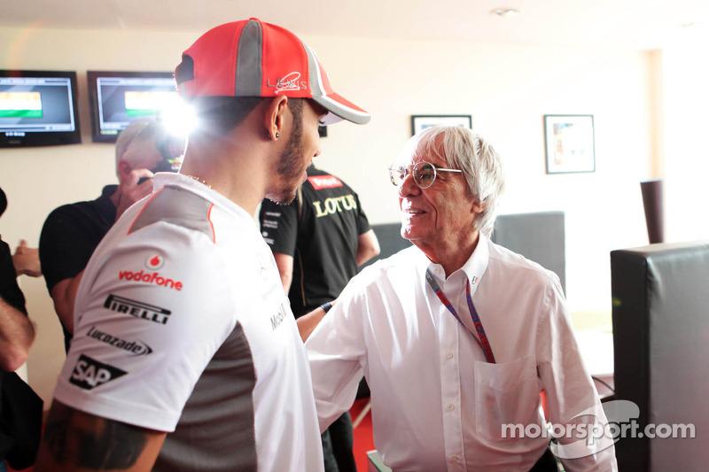 Bernie Ecclestone, CEO Formula One Group, celebrates his 82nd birthday with Lewis Hamilton, McLaren