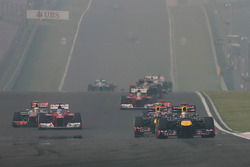 Sebastian Vettel, Red Bull Racing leads at the start of the race as Fernando Alonso, Ferrari, Lewis Hamilton, McLaren and Jenson Button, McLaren battle for position