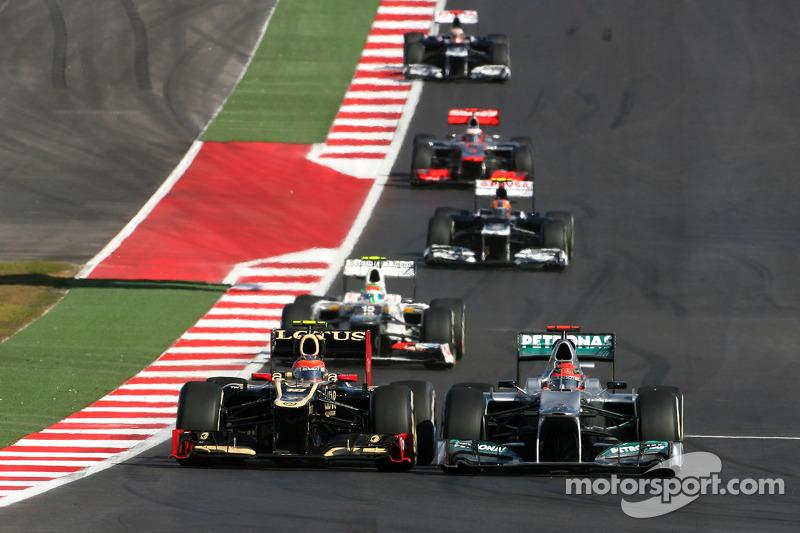 Romain Grosjean, Lotus F1 Team en Michael Schumacher, Mercedes GP