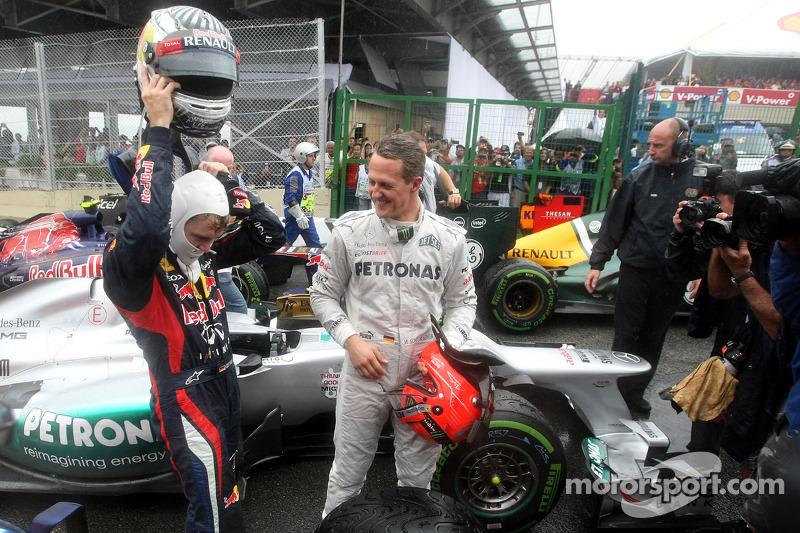 Sebastian Vettel, Red Bull Racing, y Michael Schumacher, Mercedes GP