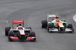 Jenson Button, McLaren leads the race from Nico Hulkenberg, Sahara Force India F1