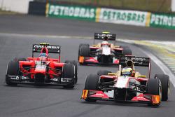 Pedro De La Rosa, HRT Formula 1 Team leads Charles Pic, Marussia F1 Team