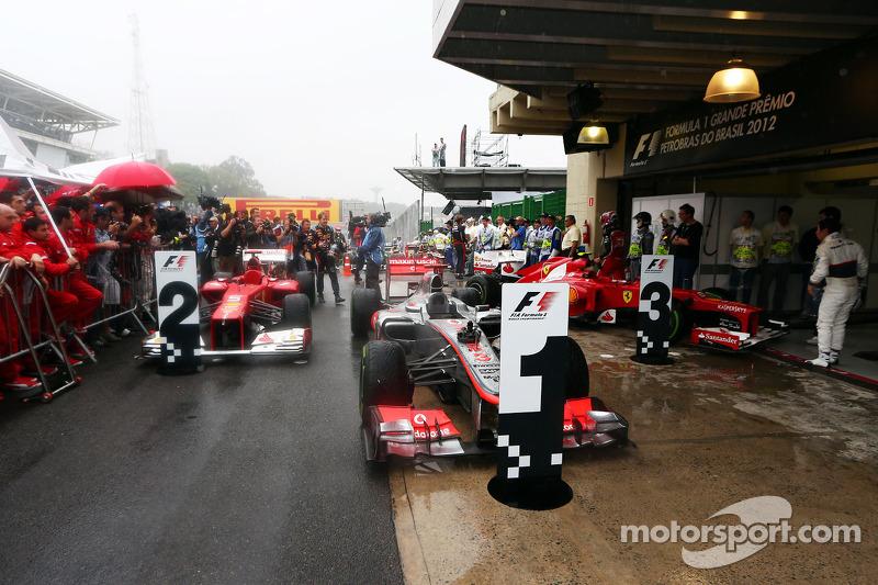 The cars in parc ferme, Fernando Alonso, Ferrari, second; Jenson Button, McLaren, race winner; Felip